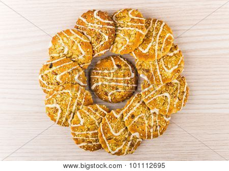 Arranged Biscuits With Sesame And Sunflower Seeds On Wooden Table