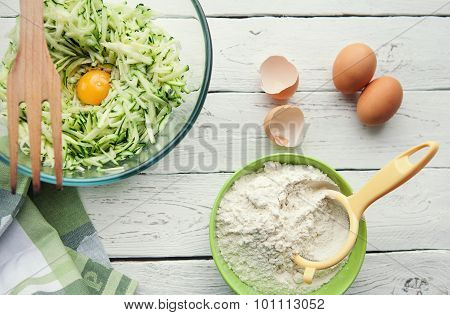 Table With Ingredients For Cooking Zucchini Pancakes