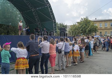 Mstera,Russia-August 8,2015: People remove and take pictures actor on scene at day of the city Mster