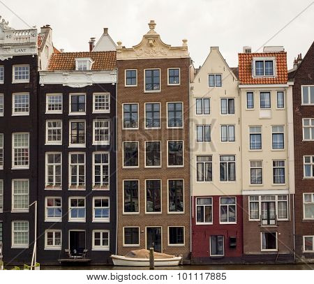 Row of traditional houses along canal in Amsterdam