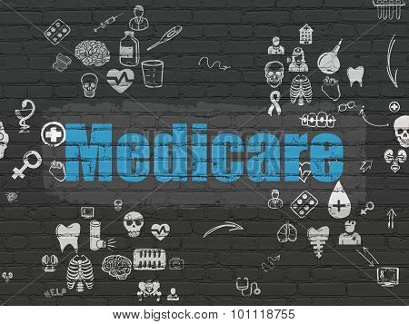 Health concept: Medicare on wall background