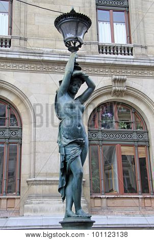 Bronze Lamppost Shaped As Antique Caryatide Near Palais Garnier, The Paris Opera House In Paris, Fra