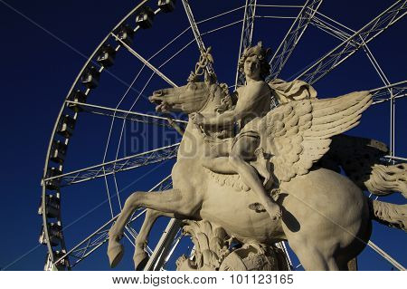 Statue Of King Of Fame Riding Pegasus On The Place De La Concorde With Ferris Wheel At Background, P