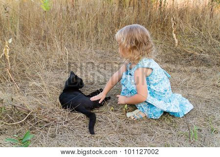 Young Kind Girl And Black Cat.