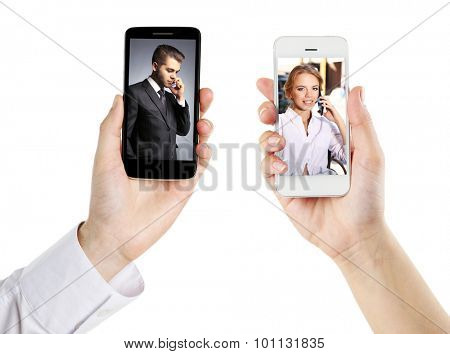 Couple on screens of phones. Online video call concept