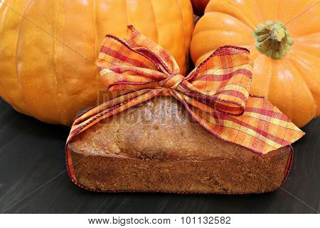 Pound Cake Wrapped In A Fall Ribbon With Pumpkins.