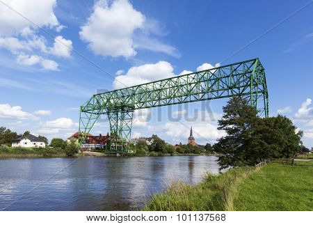 Historic transporter bridge and 18th century church at Osten, Lower Saxony
