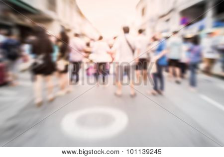 Blurred Crowd Of People On The Street