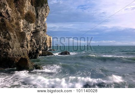 Dramatic Rocky Cliffs And Ocean Scene
