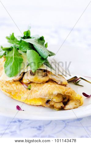 Omelette with sauteed mushrooms with fresh rocket, delicious wholesome breakfast , plenty of copy space