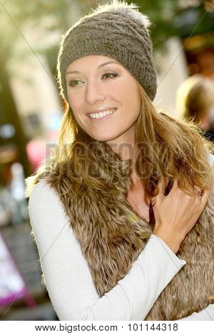 Portrait of trendy girl with winter clothes on