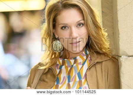 Portrait of beautiful woman in town