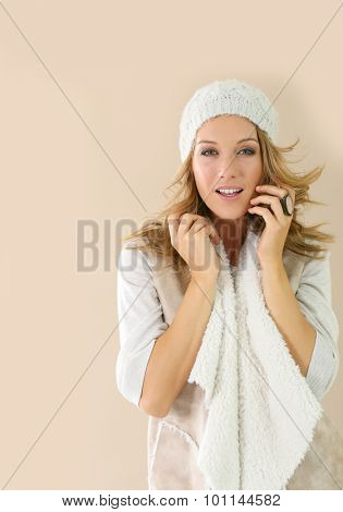 Attractive fashion woman with winter clothes, isolated