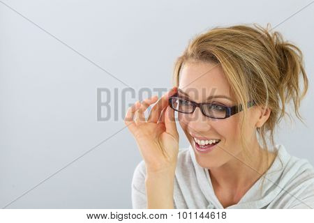 Portrait of smiling blind woman with eyeglasses, isolated