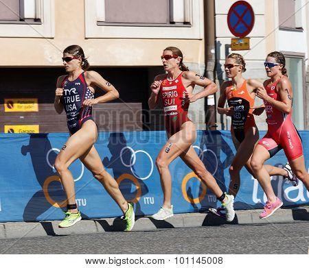 Triathlete Sarah True Running, Followed By Competitors