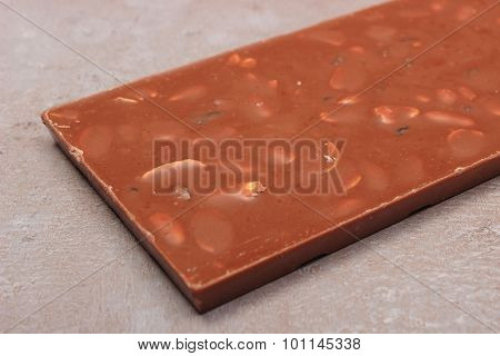 Chocolate With Nuts And Raisins On Cement Structure