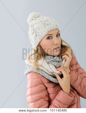 Woman model with winter outfit, isolated