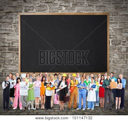 Large Workers People group near blackboard background.
