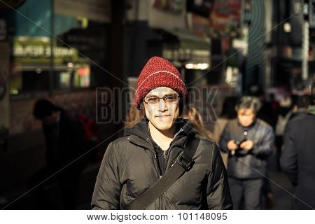 Asian Male With Winter Jacket And Hat Stand  In City Instagram Tone