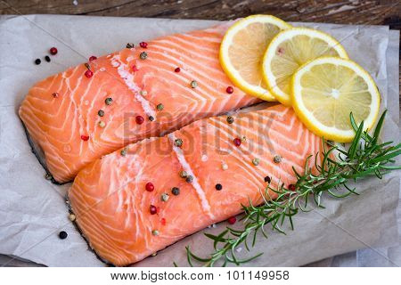 Raw Salmon Fish Fillet With Lemon, Spices And Fresh Herbs