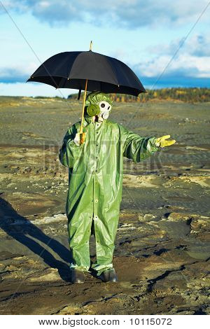 Man In Gas Mask With Umbrella Waiting For Acid Rain