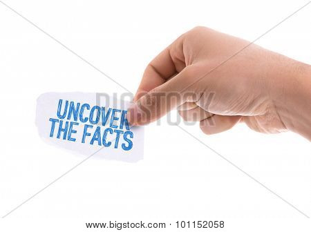 Piece of paper with the word Uncover the Facts isolated on white background