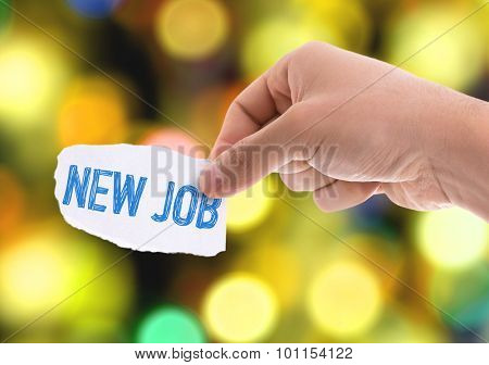 Piece of paper with the word New Job with bokeh background
