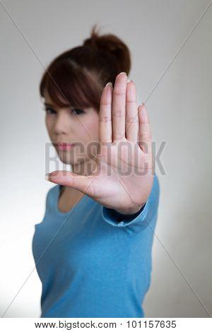 Asian Women Showing Stop Gesture