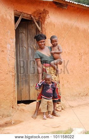An Unidentified African Woman With Her Children On The Doorstep 41