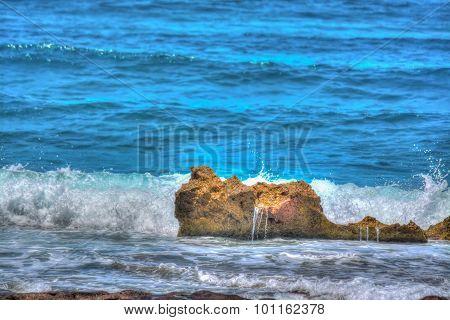 Brown Rock In Porto Ferro Blue Sea