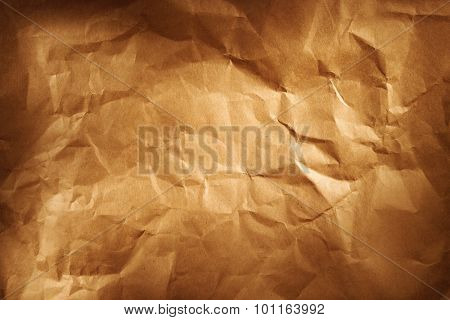 Closeup of brown wrinkled paper texture background