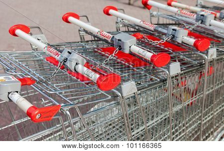 Shopping Carts Auchan Store. French Distribution Network Auchan Unites More Than 1300 Shops