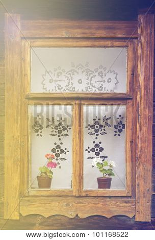 Retro old-fashioned window with retro curtains blurred effect toned photo