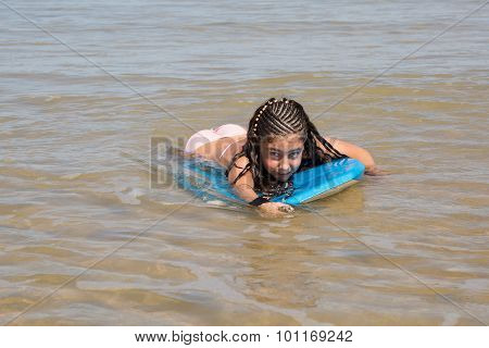 Lovely Girl Smiling At The Camera On Her Bodyboard