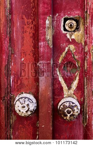 Detail Of Old Shabby Red Door