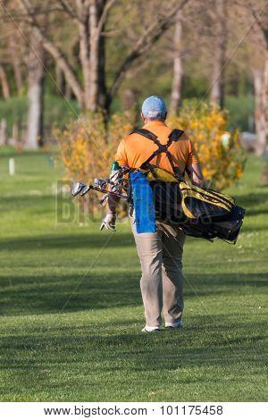 Chubby Man With Golf Bag