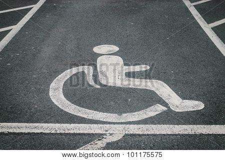 Handicapped / Disabled Parking Sign Painted On The Road Asphalt