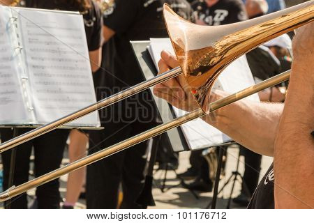 Brass Trombone, Golden Saxophone In Background