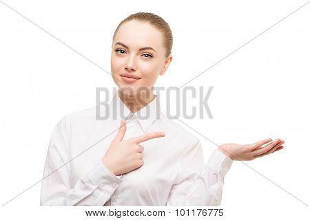 Beauty business woman portrait. Proposing a product. Beautiful girl showing empty copy space on the open hand palm for text. Gestures for advertisement. Isolated. Lady in white blouse classic