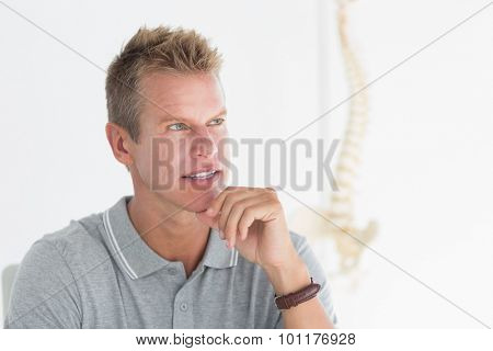Concentrated Doctor in his office in medical office