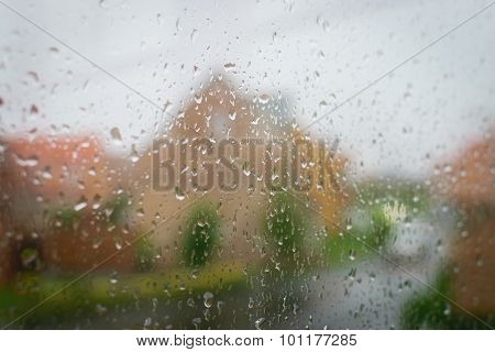 Drops Of Rain On A Window Pane, Blur House In Background.