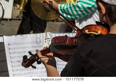 Little Violinist With White Hat During Outdoor Concert