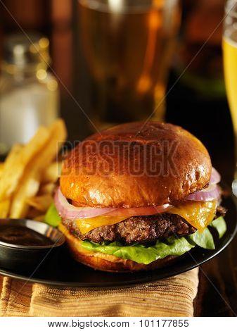 dimly lit cheeseburger in warm light