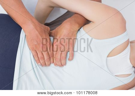 Doctor examining man back in medical office
