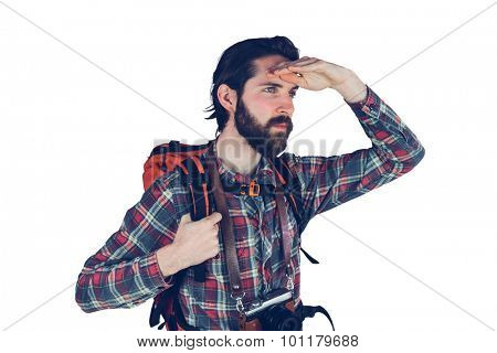 Serious adventurer looking away against white background