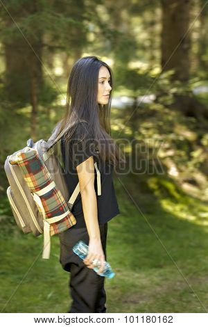 Active healthy beautiful woman hiking in  forest