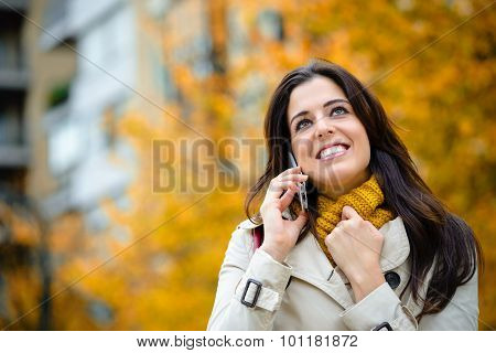 Happy Woman On Cellphone Outdoor In Autumn