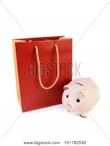 Red-orange Shopping Bag And Piggy Bank Isolated On White