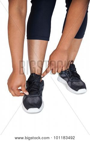 Woman trying her shoe lace on white background