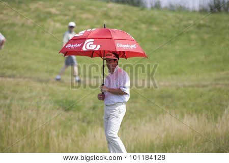 PARIS FRANCE, 02 JULY 2009. Gonzalo Fernadez-Castano (ESP) uses his umbrella to shelter him from the sun, while competing in the 1st round of the PGA European Tour Open de France golf tournament.